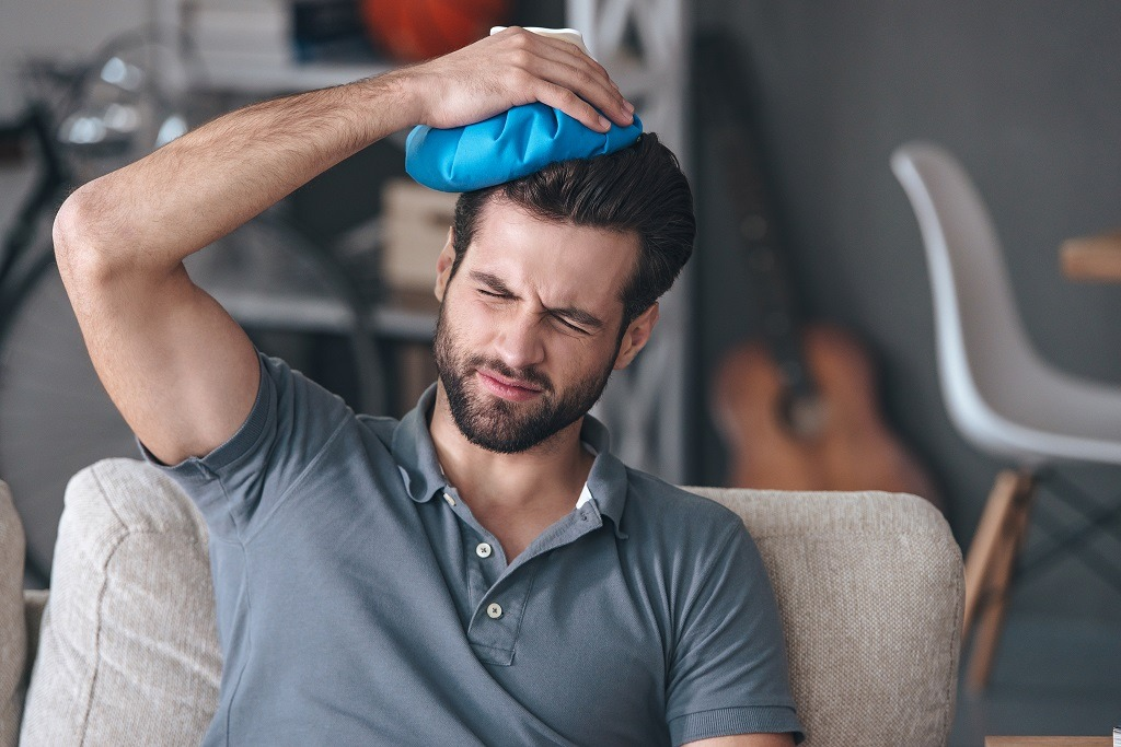 man with a headache after weed hangover