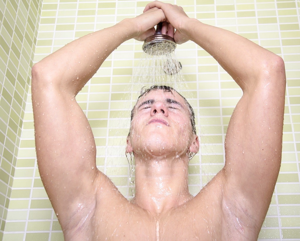 man showering to cure weed hangover